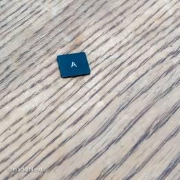 A knap til Macbook