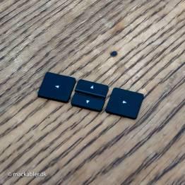 ⬅︎ Pil til venstre knap til Macbook